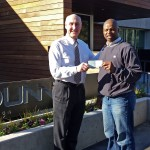 Tom Raney presents check FCA representative for Kenya Project