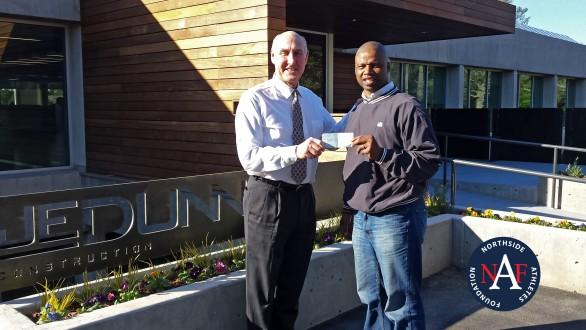 Tom Raney presents check FCA representative for Kenya Project